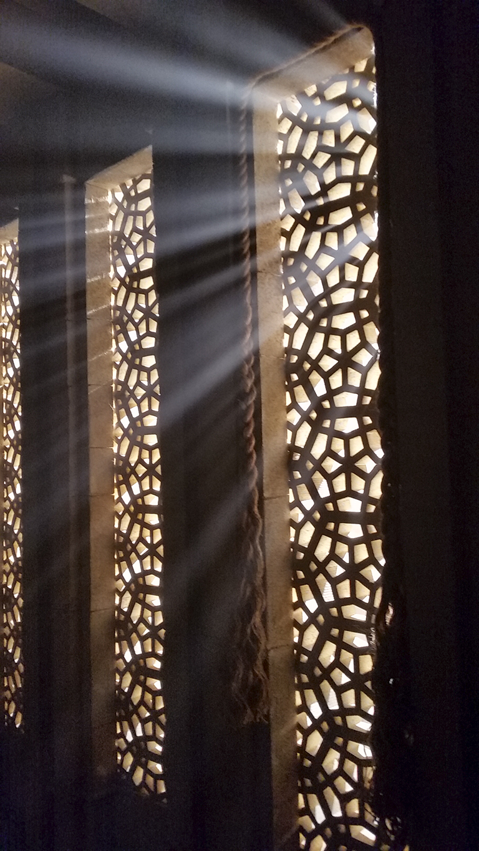 Light streaming through lattice wall, Richmond, British Columbia, Canada