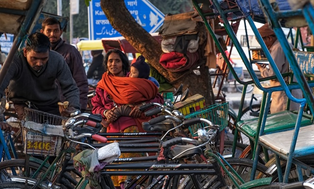 Arranging for a Bicycle Rickshaw, New Delhi, India