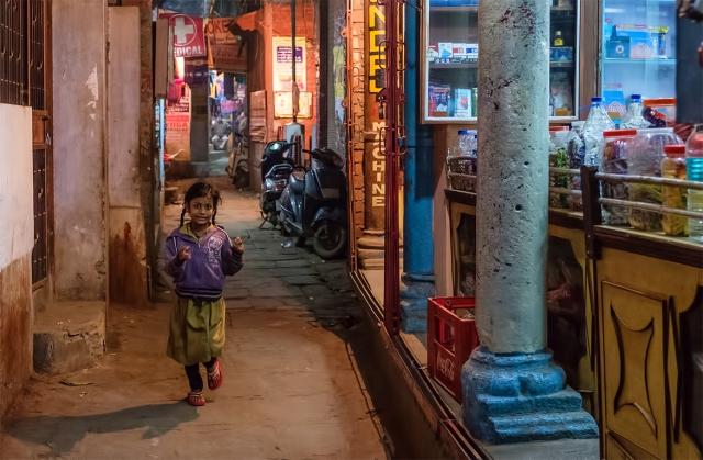 She Runs, Bengali Tola, Kashi (Old Varanasi), Uttar Pradesh, India
