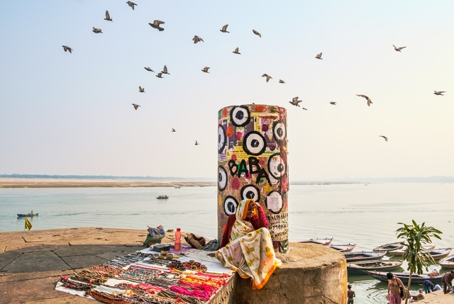 Jewellery Seller and Pigeons, The Ganga (Ganges River), Kashi (Old Varanasi), Uttar Pradesh, India copy